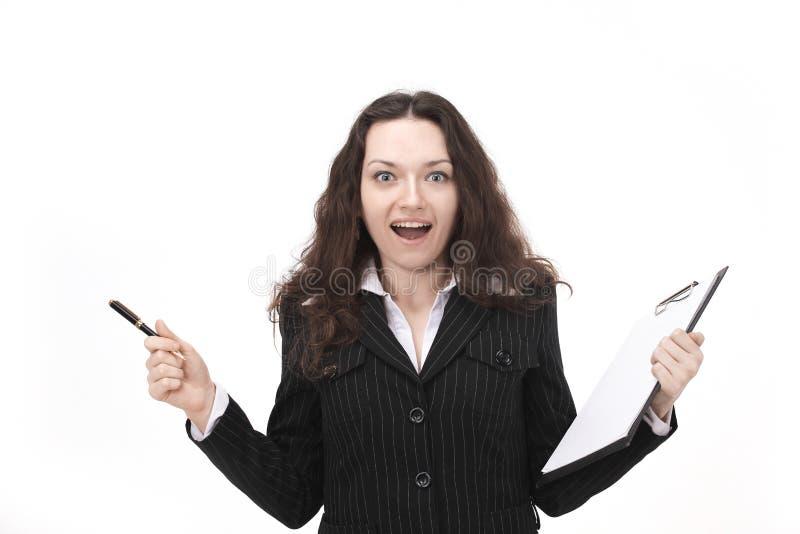 业务单据使妇女惊奇 笤帚查出的白色 免版税图库摄影