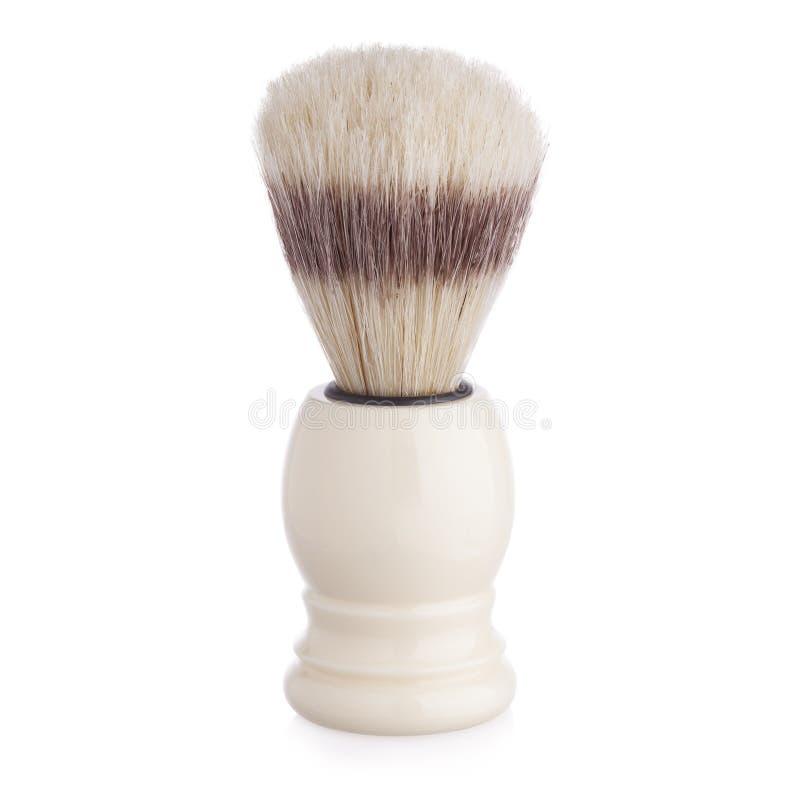 与在白色隔绝的浣熊毛皮的经典剃须刷 免版税图库摄影