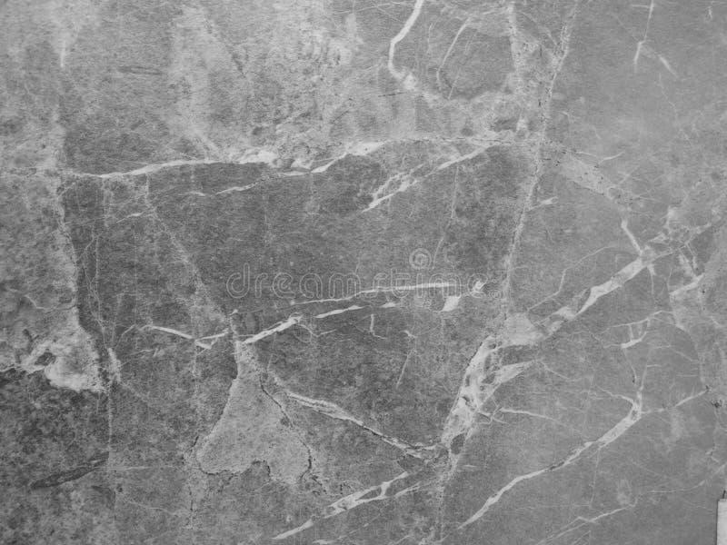 与灰色人为大理石纹理的被碾压的盘区 免版税库存照片