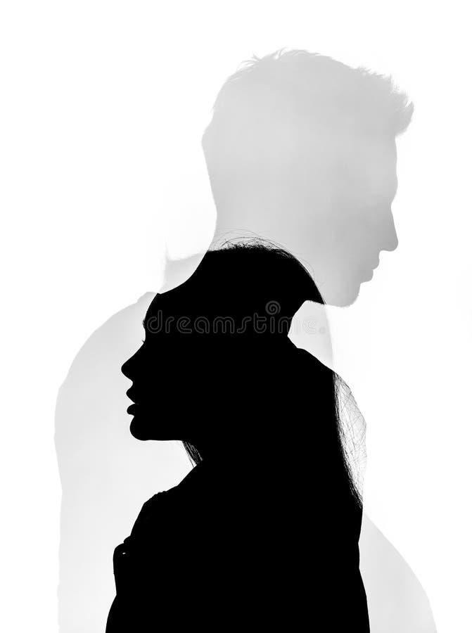 一个人和女孩剪影的艺术图片在白色背景的 库存照片