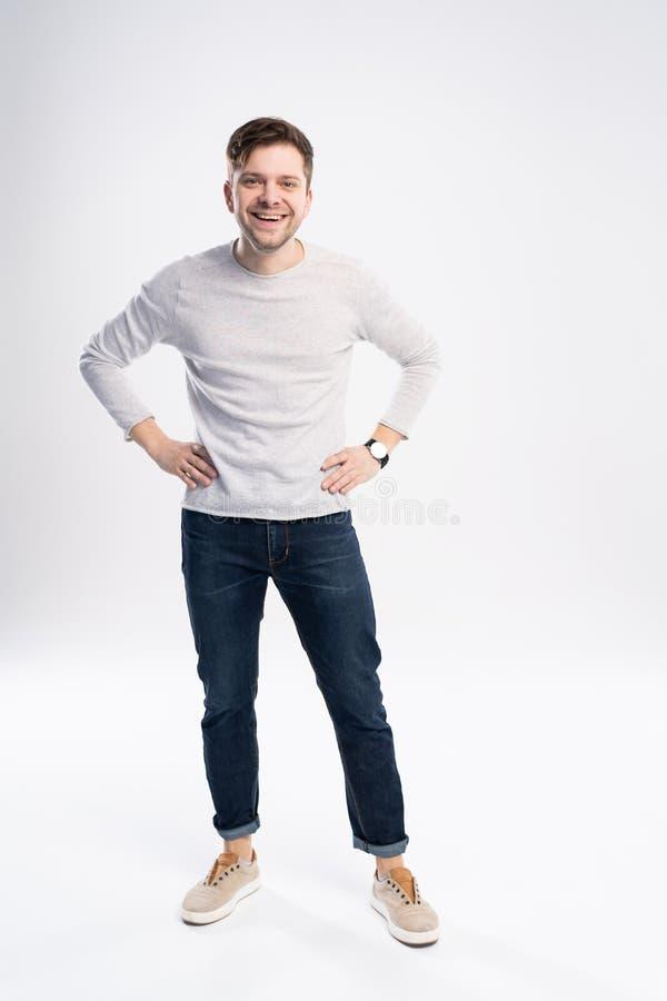 一个微笑的偶然人身分的充分的身体图片在白色背景的 库存图片