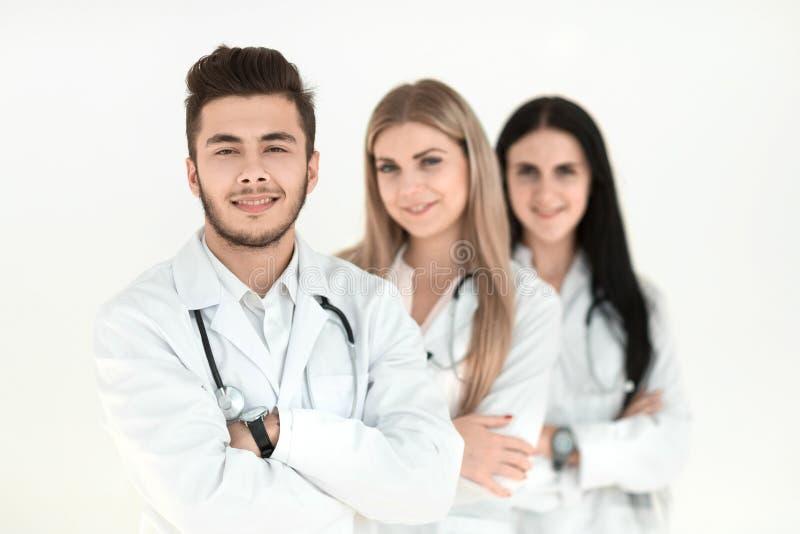 一起站立小组微笑的医院的同事 库存照片