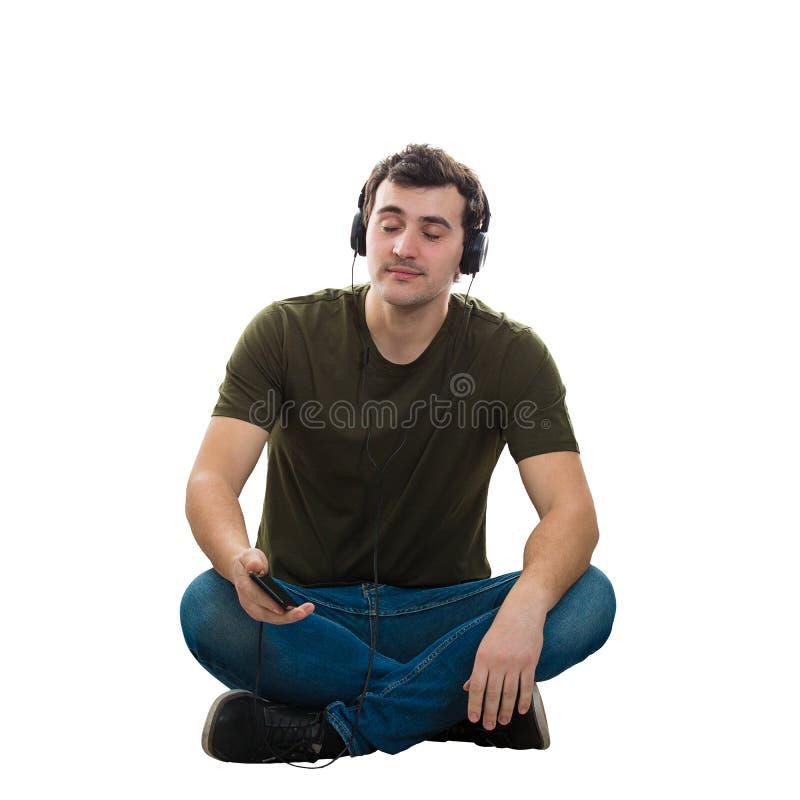 人听在耳机的音乐 库存照片