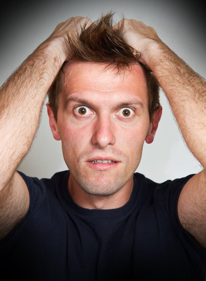 人用在他的头发的手 免版税图库摄影