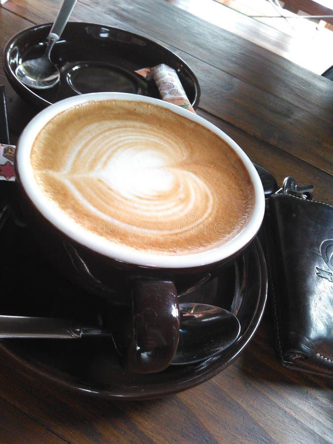 但是首先咖啡拿铁 免版税图库摄影
