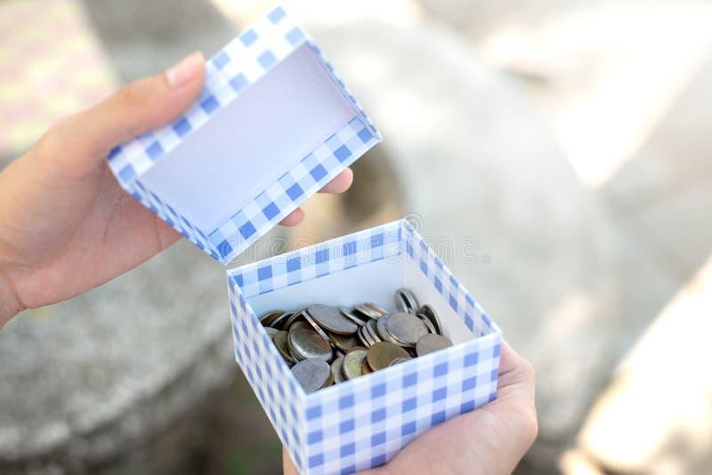 保存与硬币的金钱概念 库存图片