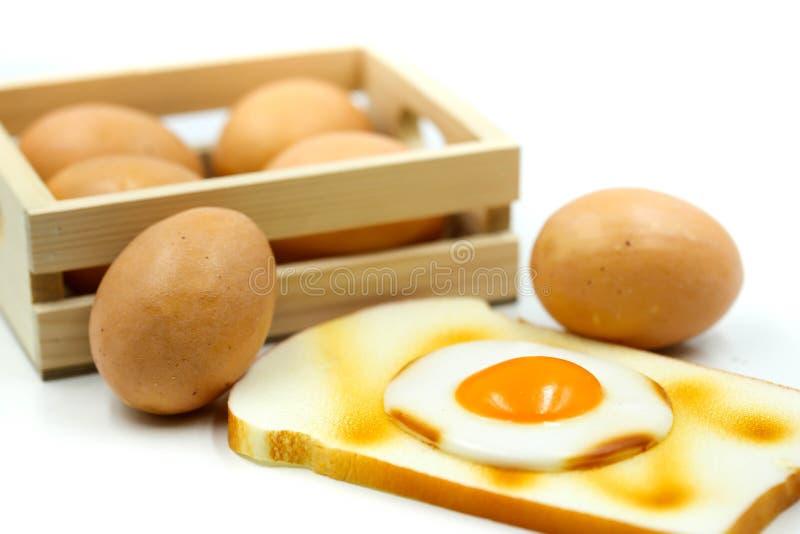 Ägg för frukost med rostat bröd arkivbilder