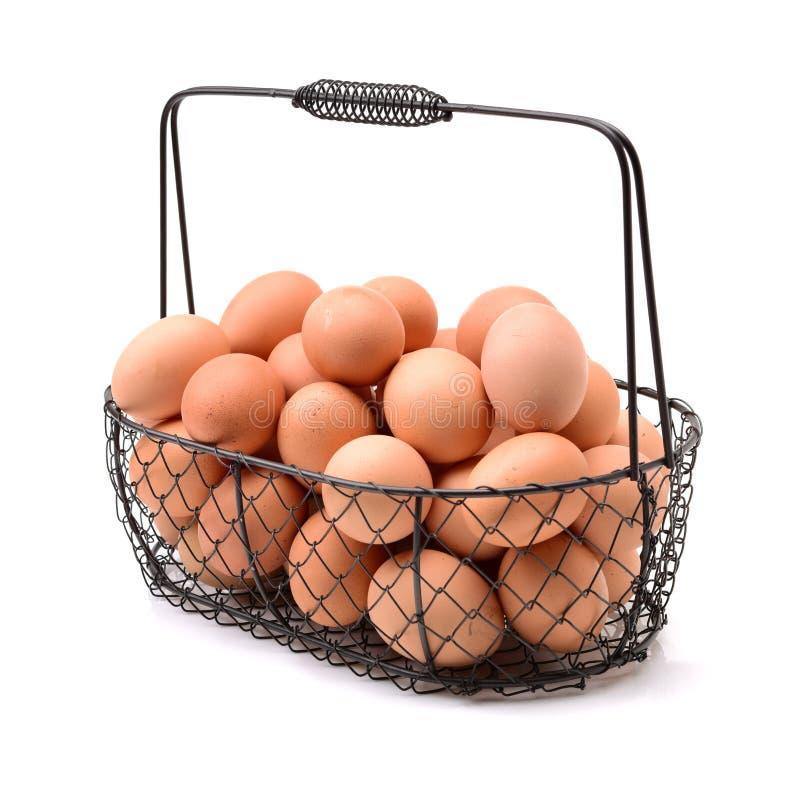 Ägg och äggkorg arkivbilder