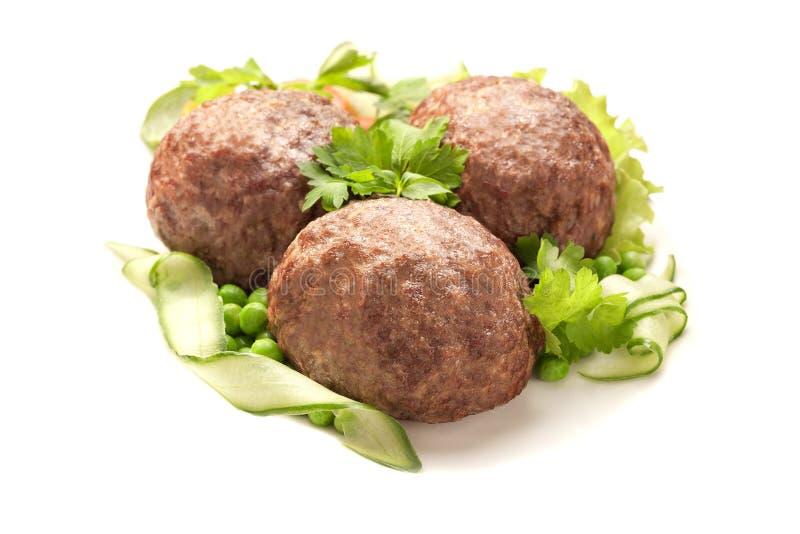 Ägg som slås in i köttfärs royaltyfria bilder