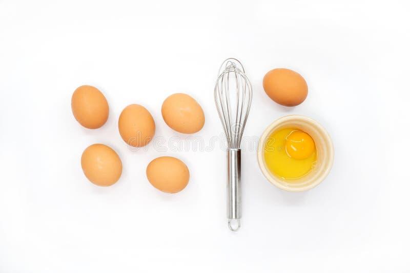 Ägg viftar och en äggula arkivfoto