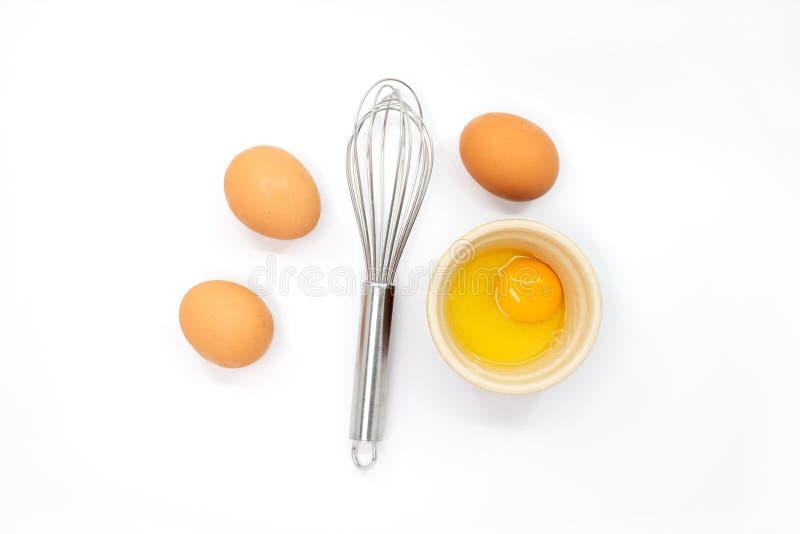 Ägg viftar och en äggula arkivfoton