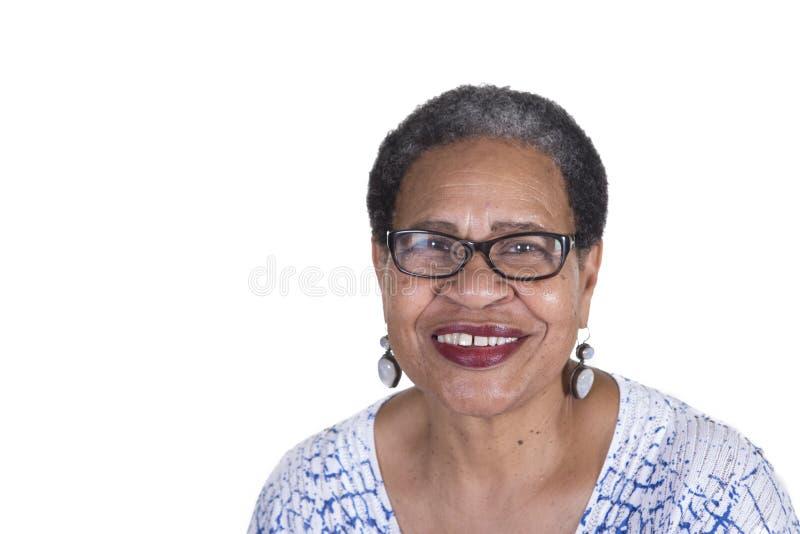 Äldre kvinna med exponeringsglas arkivbild