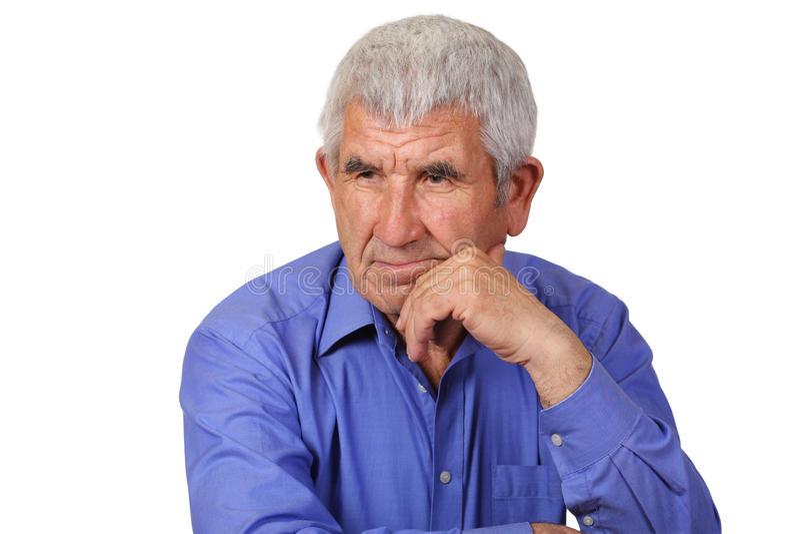 Äldre man som är borttappad i tanke arkivfoto