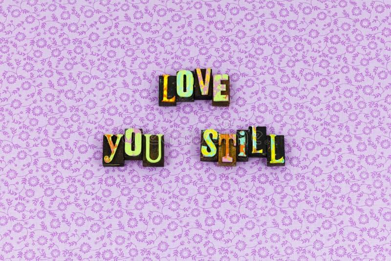 Älska dig fortfarande för evigtsinnesrörelseboktryck arkivbild