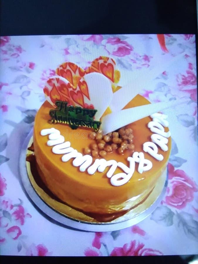 Älskvärd kaka för årsdag royaltyfri fotografi