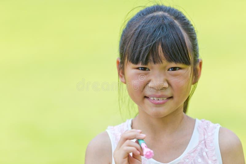 Älskvärd Orient liten flicka royaltyfri foto