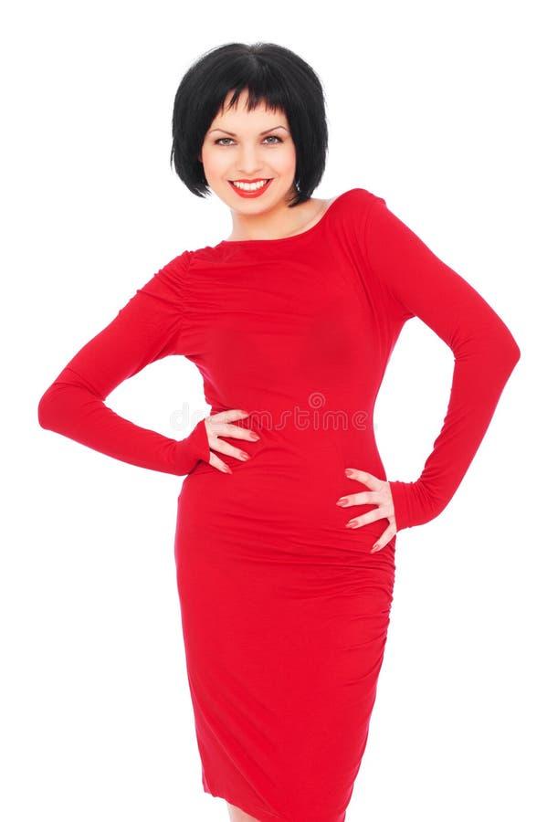 älskvärd röd kvinna för klänning fotografering för bildbyråer