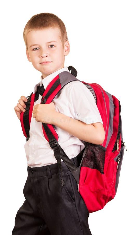 Älskvärd student med den röda ryggsäcken som isoleras på vit bakgrund royaltyfri fotografi