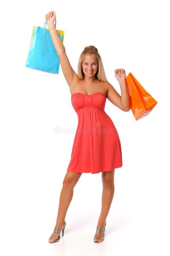 älskvärt shoppingkvinnabarn royaltyfri foto