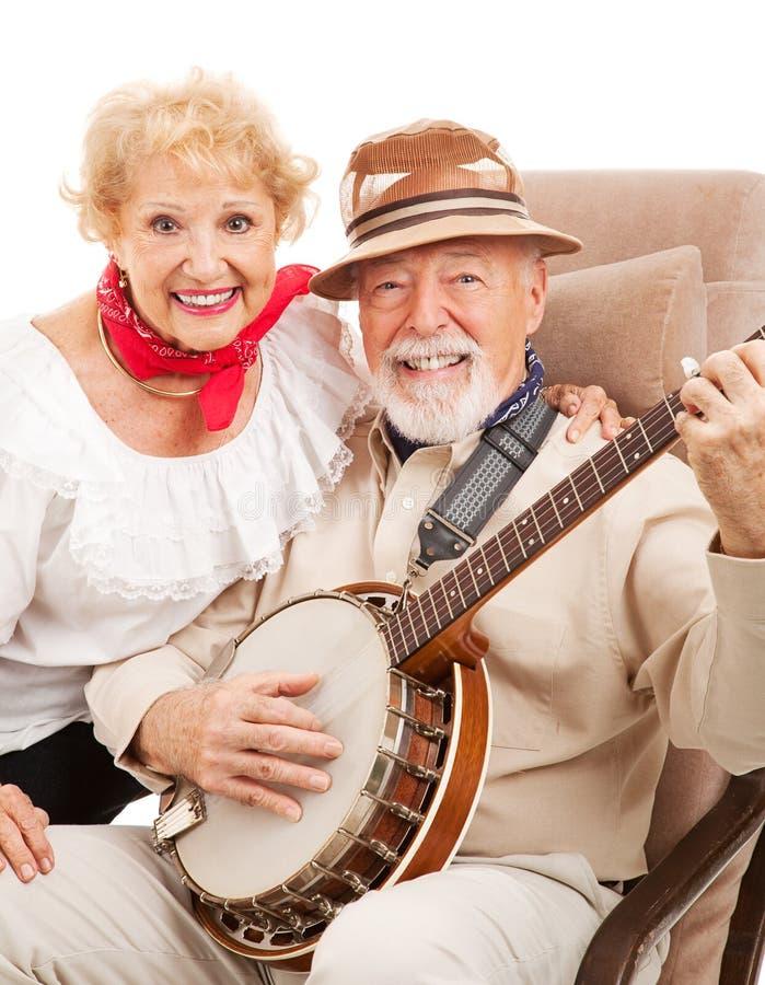 Ältere Countrymusik-Paare lizenzfreie stockbilder