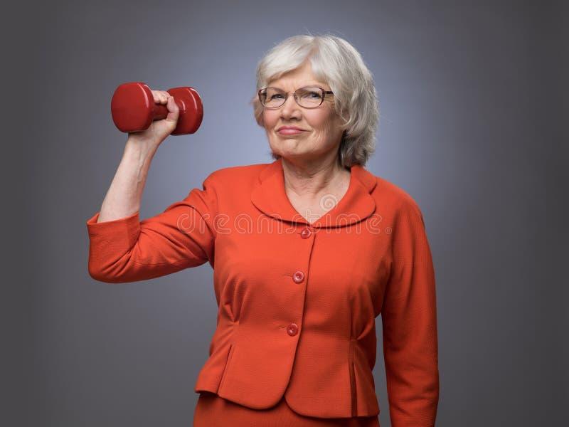 Ältere Dame mit Dummkopf lizenzfreie stockfotos