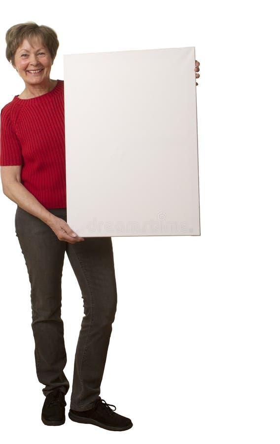 Ältere Dame mit Plakat stockfoto
