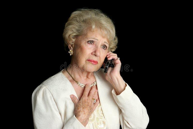 Ältere Dame - traurige Nachrichten lizenzfreie stockfotografie
