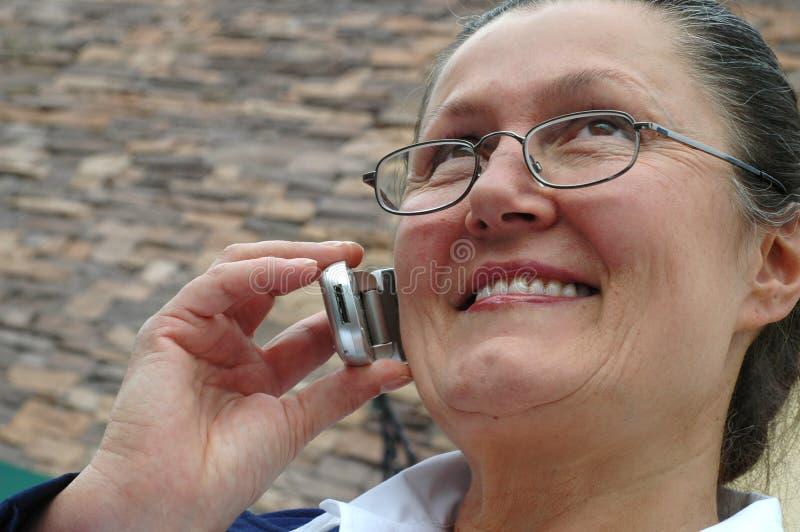 Ältere Frau im Unternehmensw lizenzfreie stockfotos