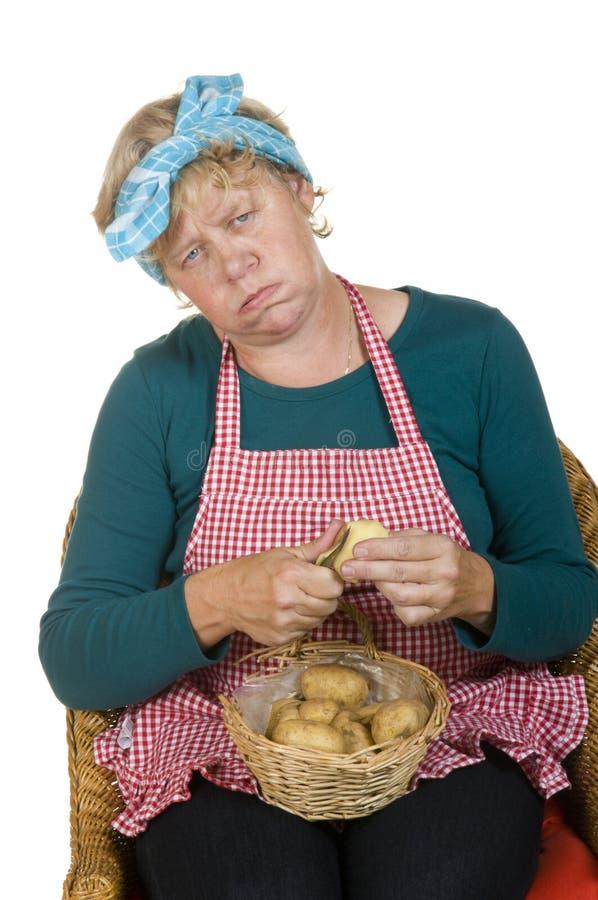 Ältere gebohrte Hausfrau stockbilder
