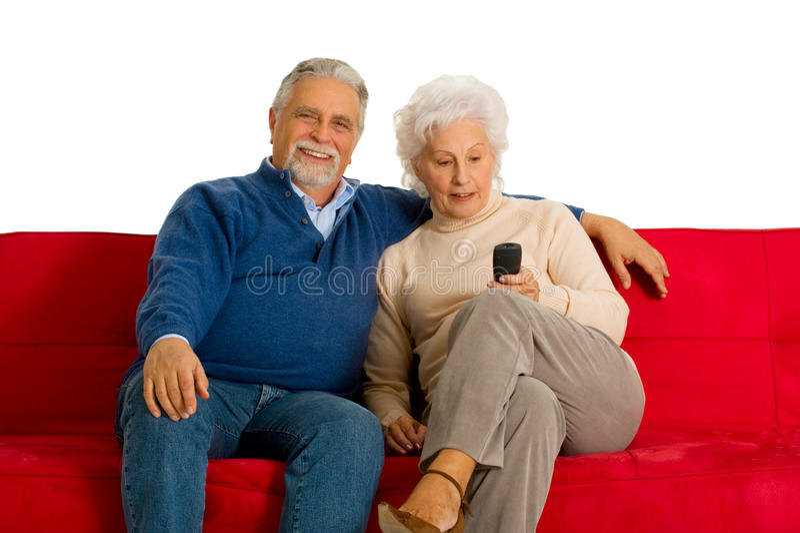 Ältere Paare auf dem Sofa lizenzfreies stockbild