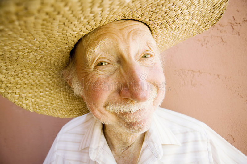 Älterer Bürger-Mann in einem Cowboyhut lizenzfreie stockfotos