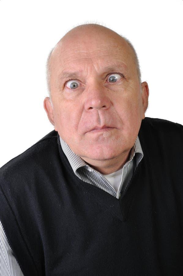 Älterer Mann, der Gesichter macht stockfoto