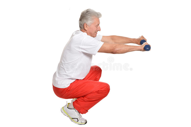 Älterer Mann, der Sport spielt stockbild