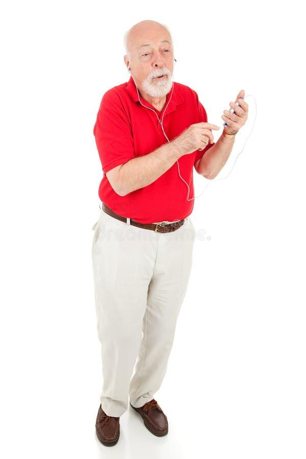 Älterer Mann mit MP3-Player - volle Karosserie lizenzfreie stockfotografie