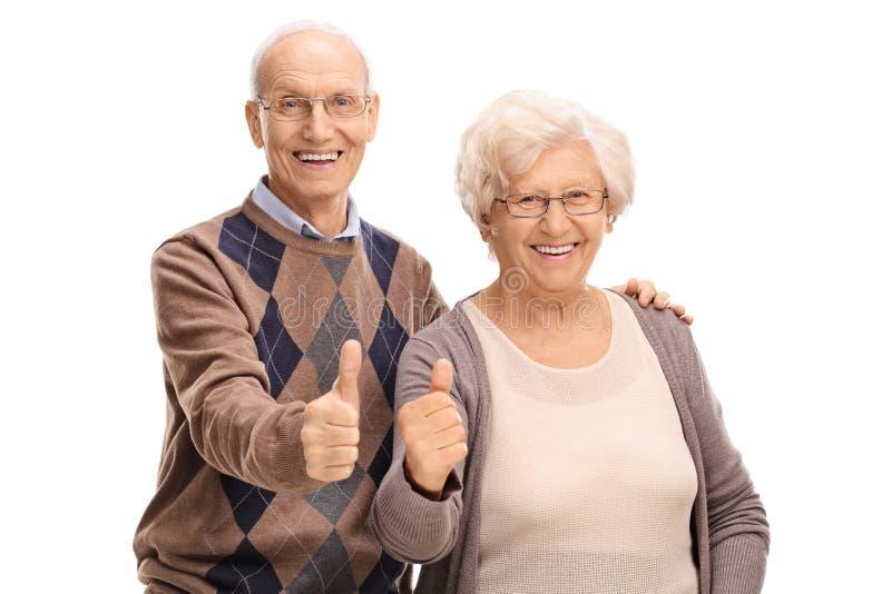 Älterer Mann und Frau, die Daumen aufgibt lizenzfreie stockbilder