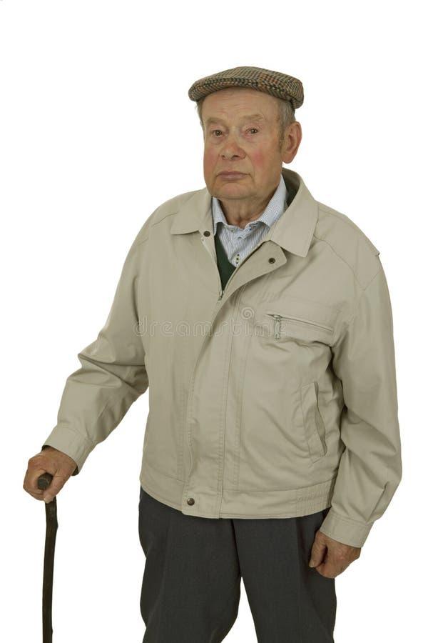 Älterer mit gehendem Steuerknüppel stockbild