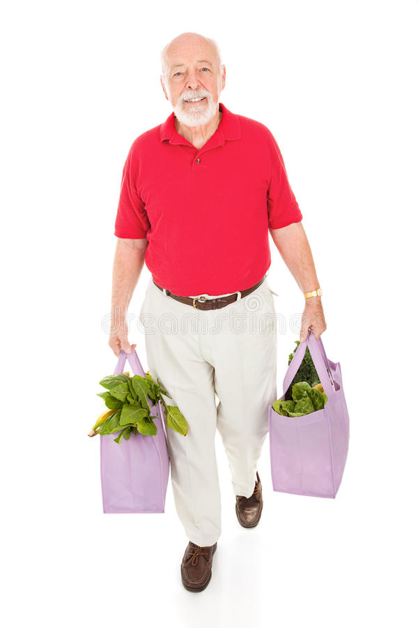 Älterer mit mehrfachverwendbaren Lebensmittelgeschäft-Beuteln stockbilder