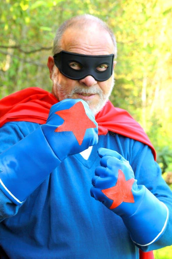 Älterer Superheld stockbild