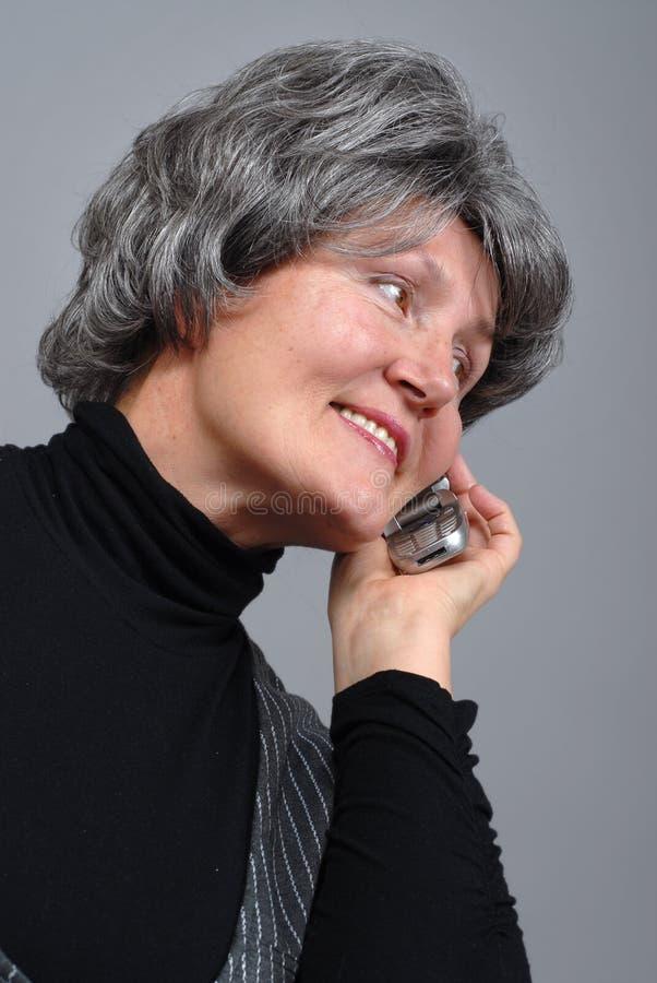 Älterer am Telefon stockfoto