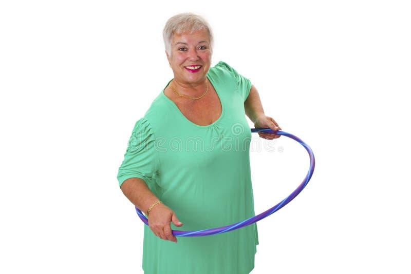 Älteres Damenhandeln gymnastisch lizenzfreie stockbilder