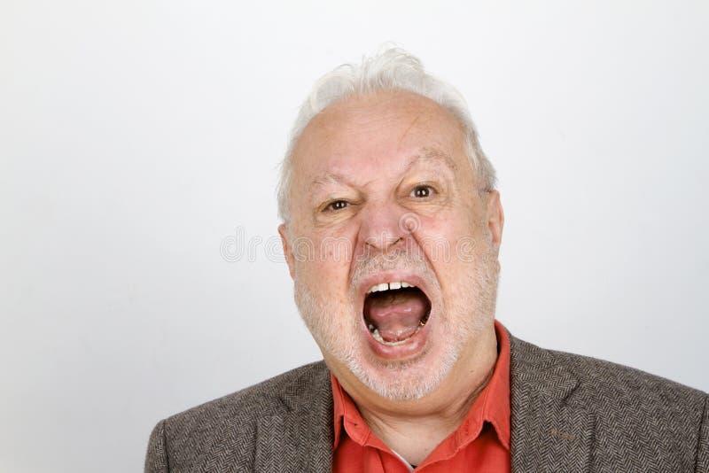 Älteres Personenschreien aggressiv stockfoto