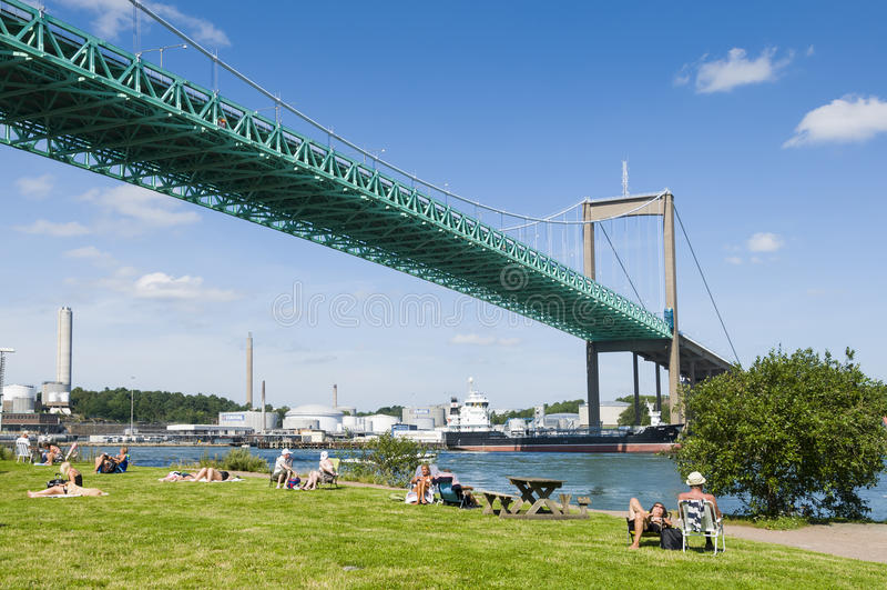 "Ã""lvsborg bridge Gothenburg Sweden. Sunbathing people at Ã""lvsborg bridge (Swedish: Ã""lvsborgsbron) in Gothenburg (Swedish: Gothenburg), Sweden royalty free stock photography"