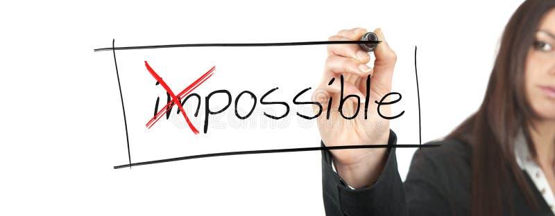 Ändra det omöjligt in i möjligt arkivfoton