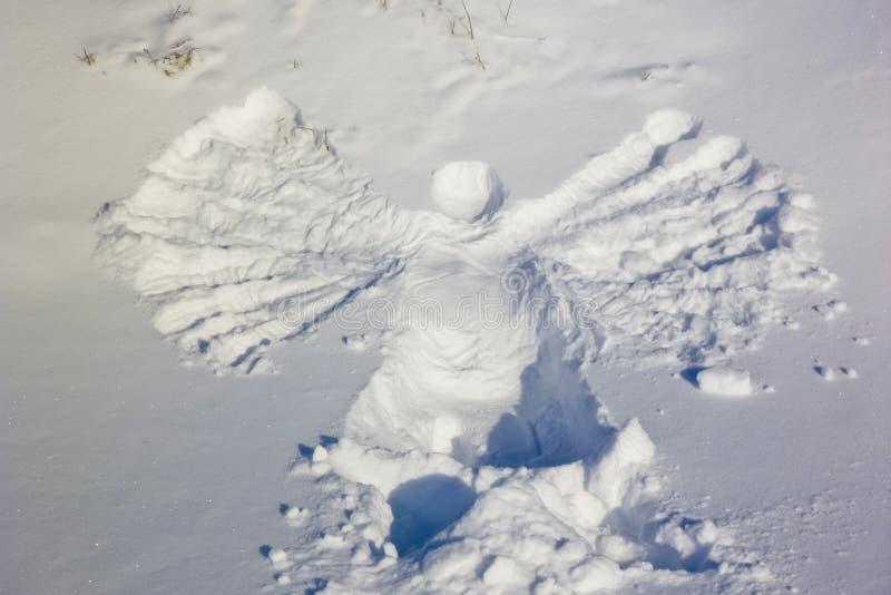 Ängel i snön royaltyfri foto