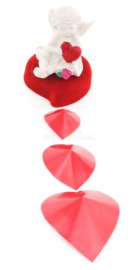 Ängel på en röd hjärta arkivfoto