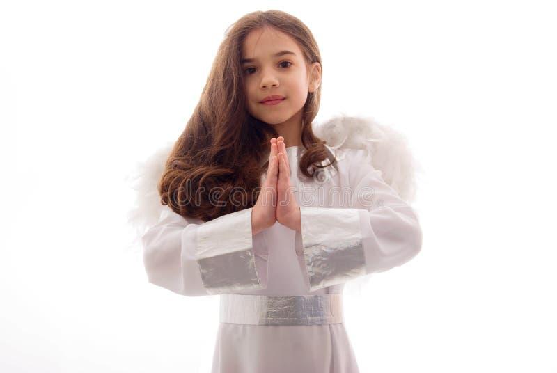 ängel tacksamt little som ber arkivbild