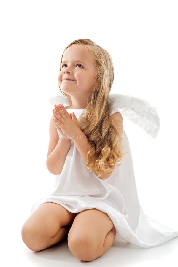 ängel tacksamt little som ser upp royaltyfria foton