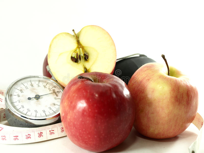 Äpfel, messendes Band, Blutdruck-Pumpe lizenzfreie stockfotografie