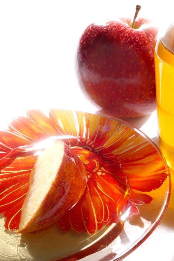 Äpfel und Honig lizenzfreie stockbilder