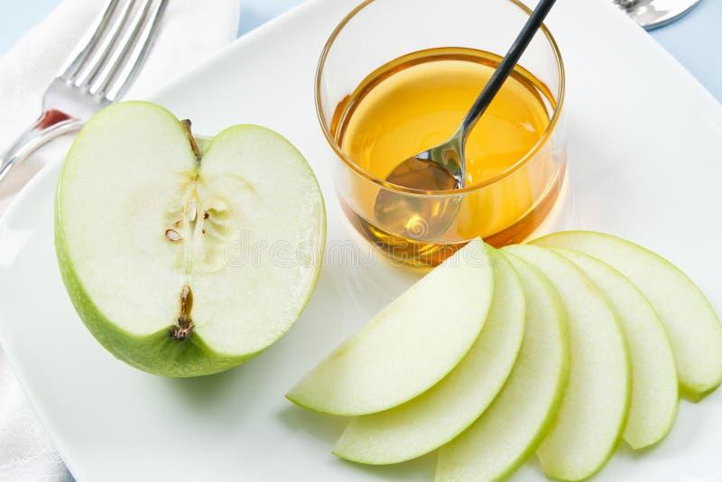 Äpfel und Honig für Rosh Hashanah lizenzfreies stockfoto